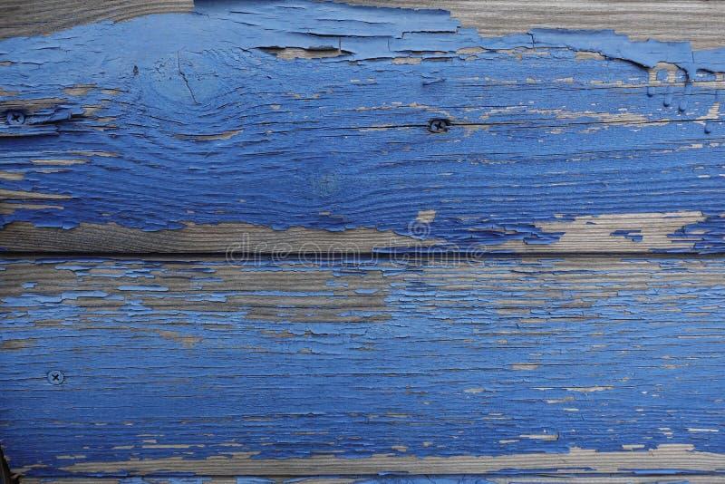 Vieux conseils arrondis avec la peinture de épluchage bleue Concepteur abstrait Background images stock
