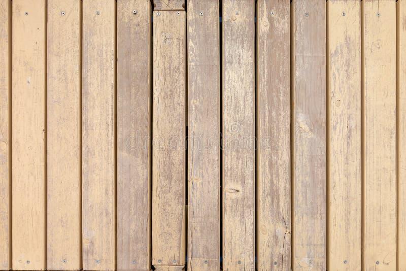 Vieux conseils en bois avec la peinture beige croisée photographie stock