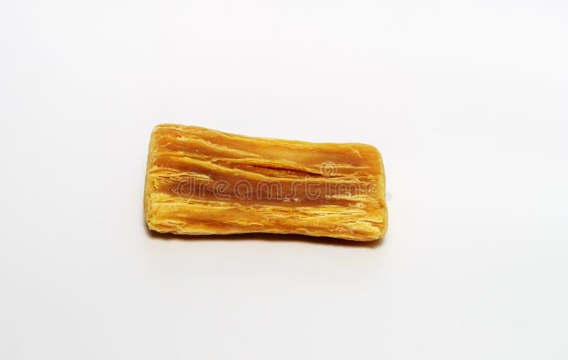 Vieux coup de racloir naturel de savon sur le fond blanc photographie stock libre de droits