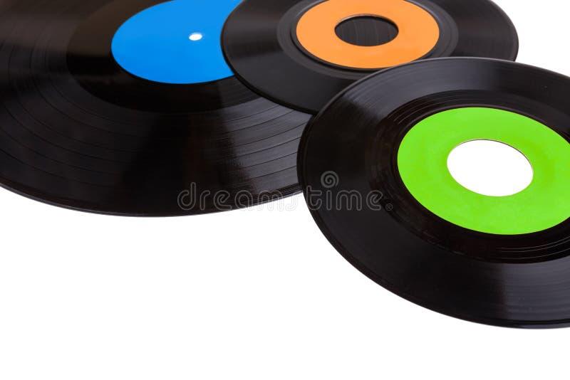 Vieux disques vinyle de phonographe d'isolement sur le fond blanc photos stock