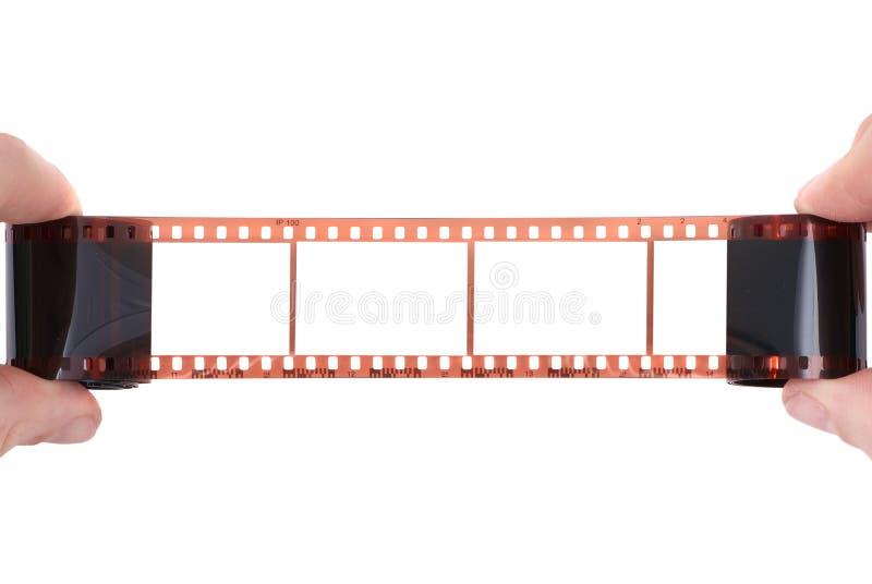 Vieux film avec la trame vide dans les mains photos stock