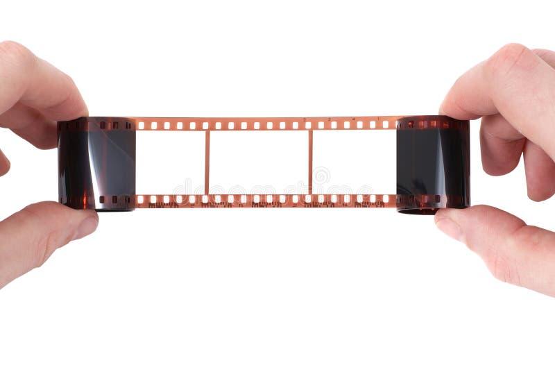 Vieux film avec le cadre vide dans les mains photos stock