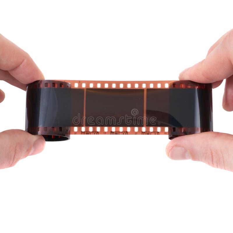 Vieux film photographique dans les mains images stock