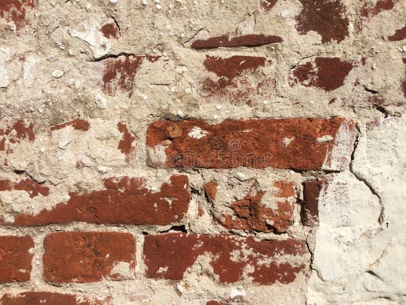 Vieux fond de texture de mur de briques de fente image stock