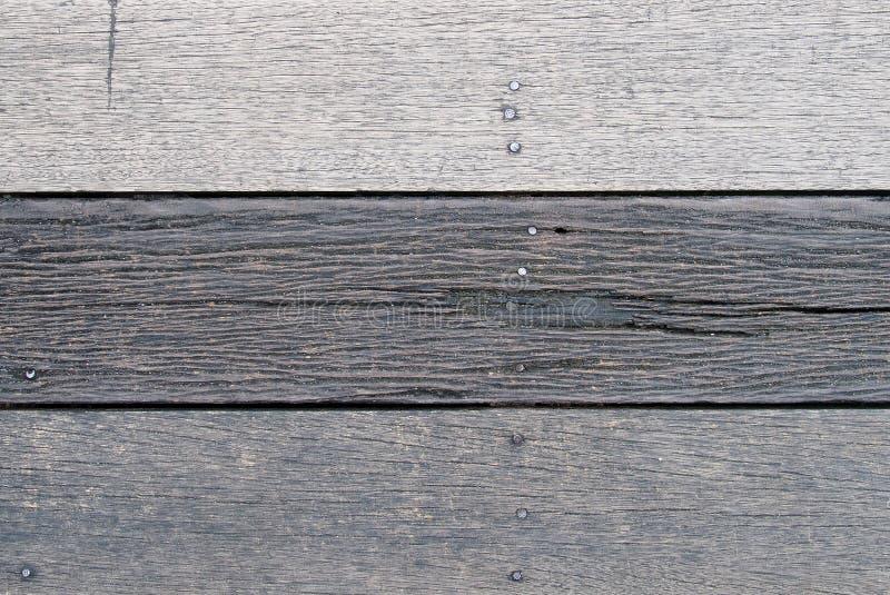 Vieux fond en bois gris-foncé rustique superficiel par les agents de texture de plancher ou de mur de planche photographie stock libre de droits