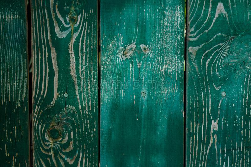 Vieux fond en bois vert-foncé fané de parquet avec des fissures photos stock