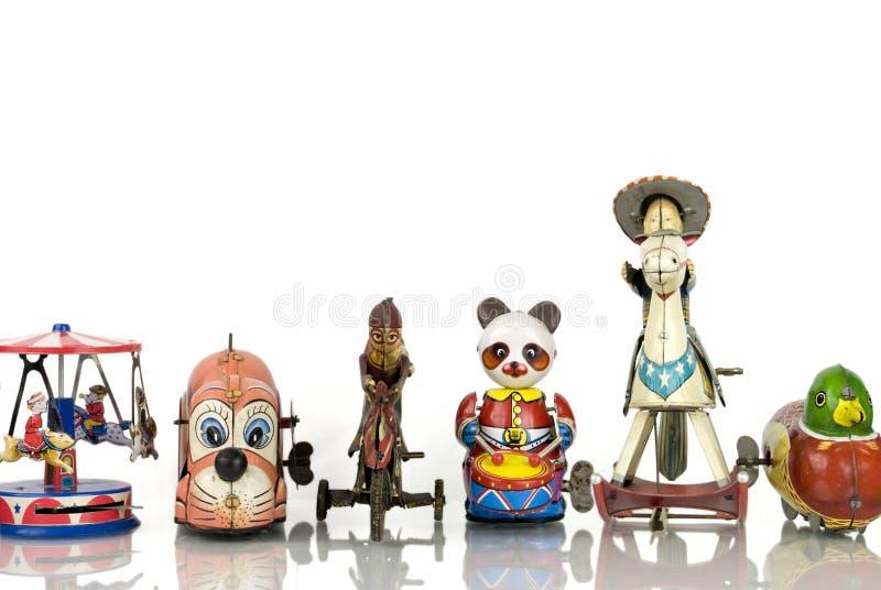 Vieux jouets de bidon photographie stock libre de droits