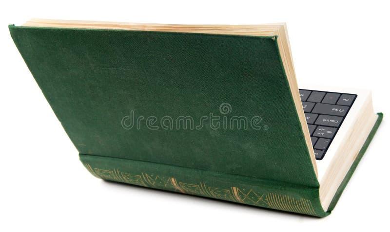 Vieux livre comme ordinateur portatif images libres de droits