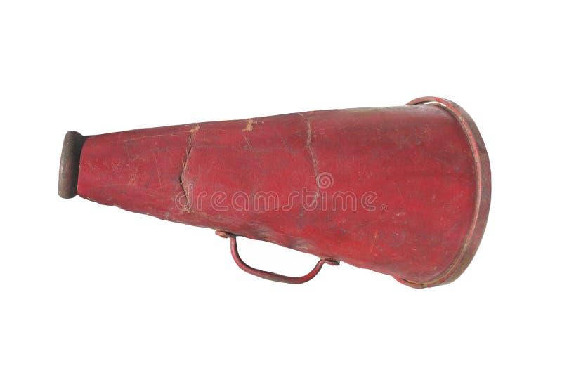 Vieux mégaphone tenu dans la main d'isolement. image stock