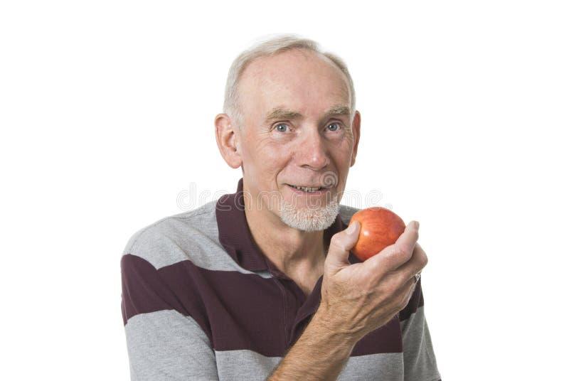 Vieux mangeur d'hommes une pomme photographie stock libre de droits