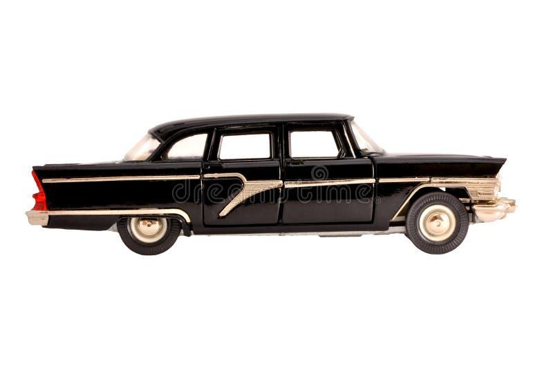 Vieux modèle d'échelle de rétro limousine noire d'isolement photos stock