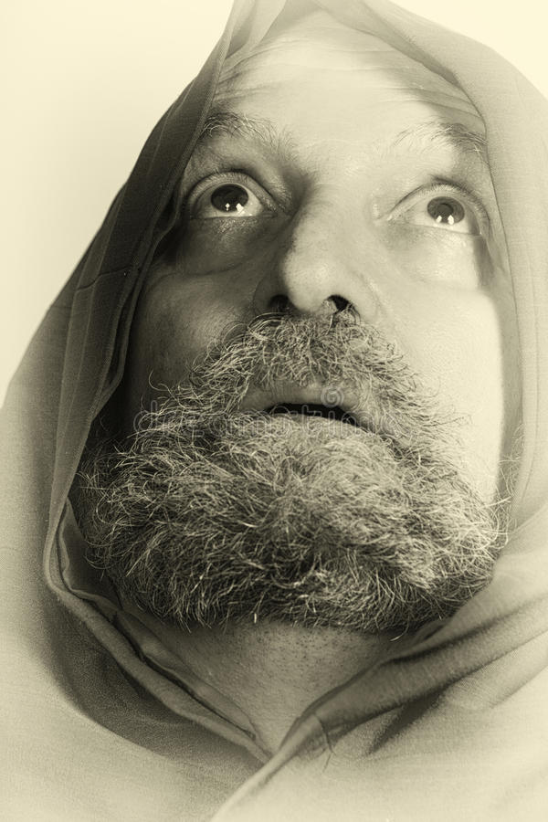 Vieux moine saint de capucin de carte de prière avec la barbe photos libres de droits