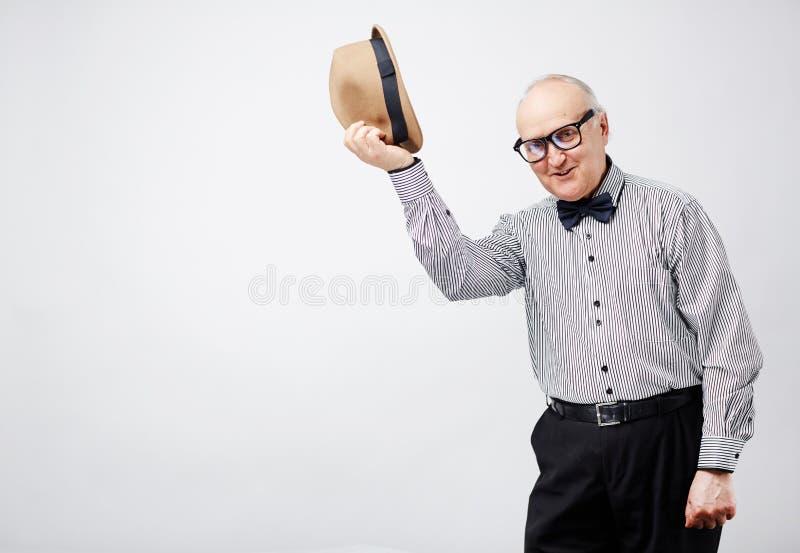Vieux monsieur avec des façons image libre de droits