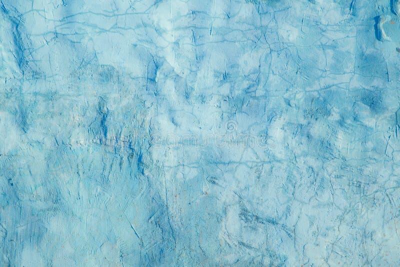 Vieux mur bleu de ciment avec des fissures photo libre de droits