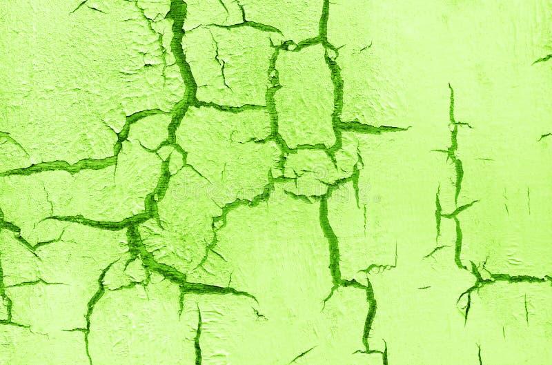 Vieux mur criqué endommagé de peinture, fond grunge, couleur verte image stock