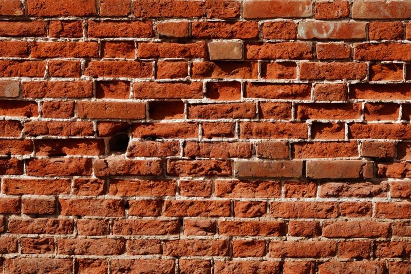 Vieux mur de briques, vieille texture de plan rapproch? en pierre rouge superficiel par les agents de blocs photo stock
