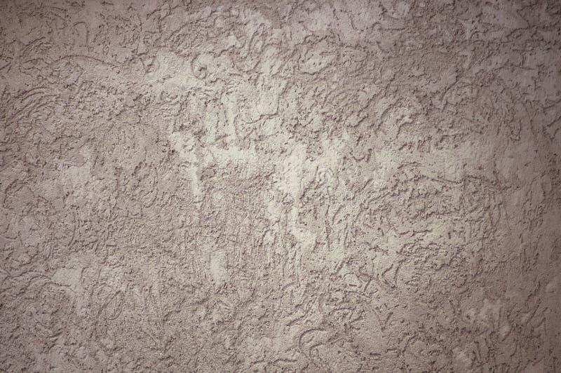 Vieux mur de ville de pl?tre texturis? gris avec des fissures images stock