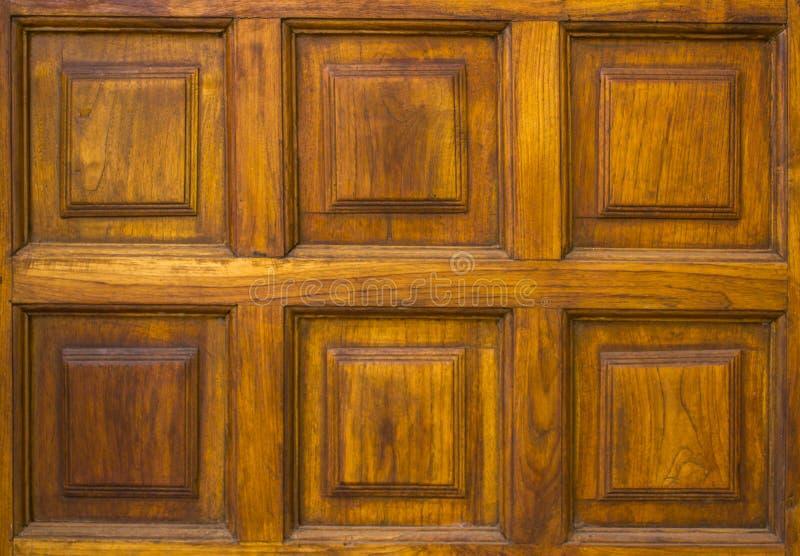 Vieux mur en bois brun jaune avec le modèle carré Texture de surface approximative images libres de droits