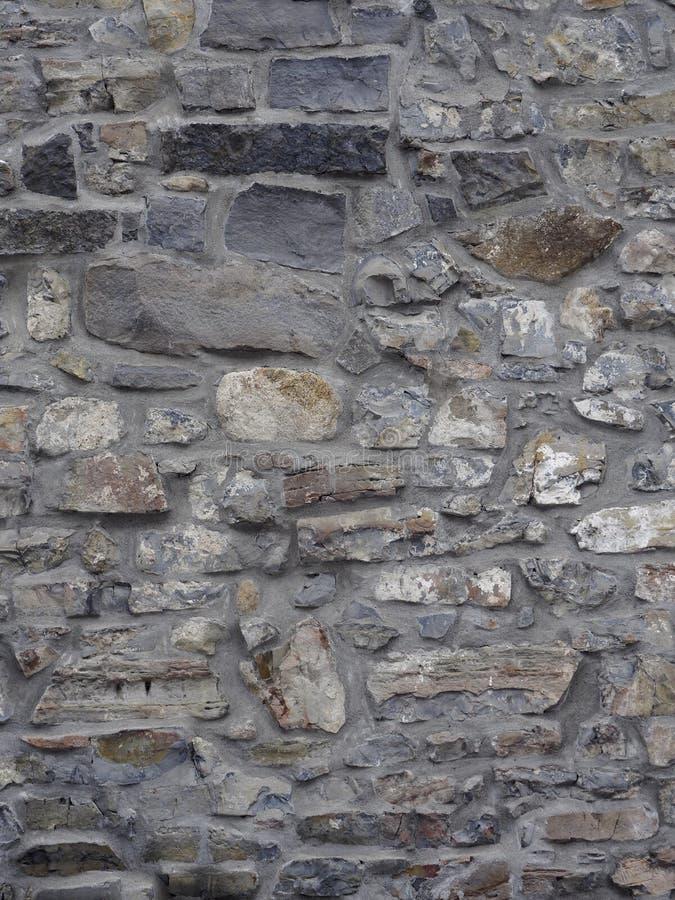 Vieux mur en pierre avec des couleurs grises, blanches et brunes image stock