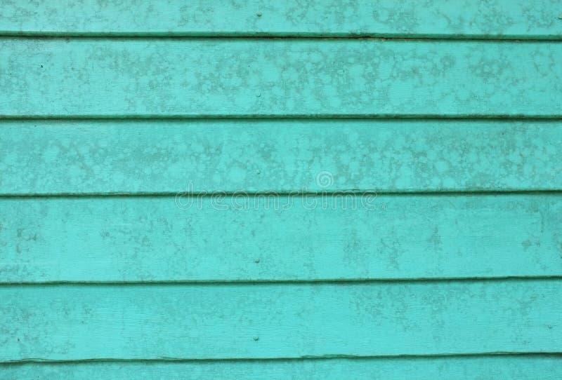 Vieux mur vert de conseils en bois photographie stock