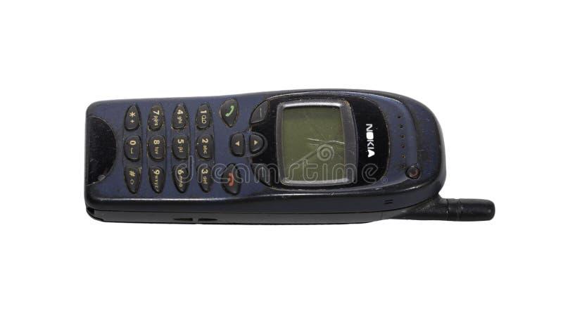 Vieux Nokia antique téléphonent au-dessus du blanc images stock