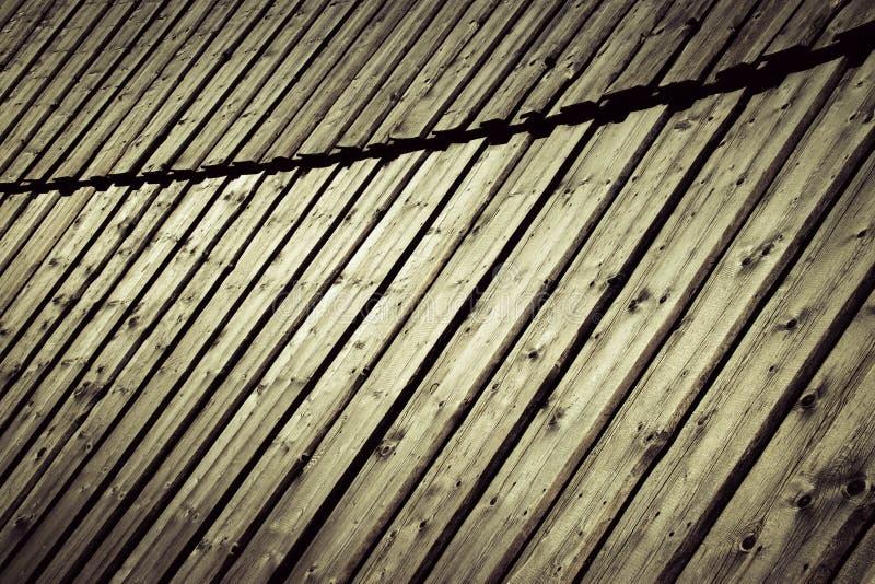 Vieux panneautage en bois dans l'arc photo stock