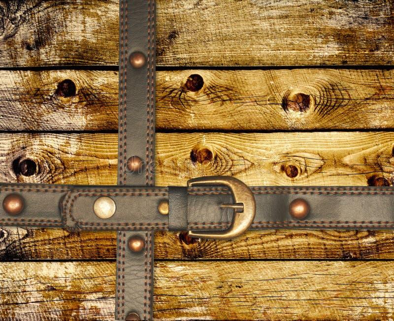 Vieux panneaux en bois et courroie en cuir photo stock