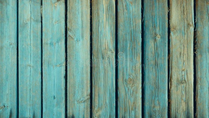 Vieux panneaux en bois superficiels par les agents et affligés avec des traces de peinture de vert de sarcelle d'hiver image libre de droits