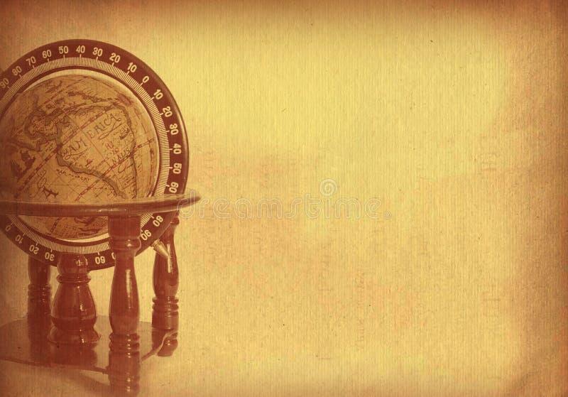 Vieux papier texturisé avec le globe illustration stock