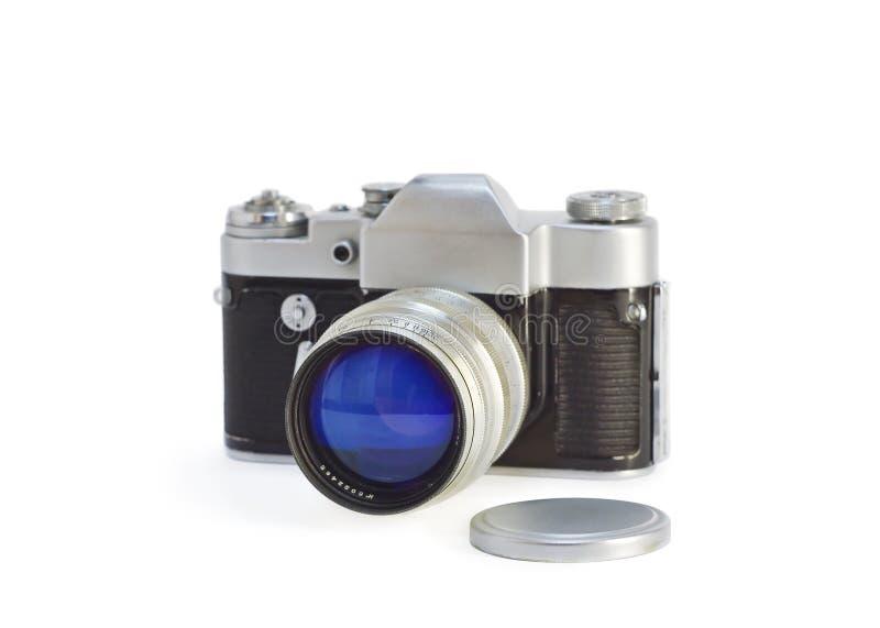 Vieux photocamera avec le capuchon de lentille photos stock