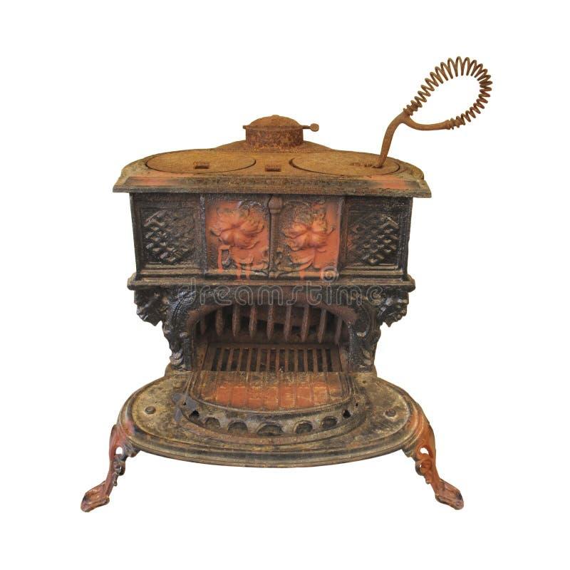 Vieux poêle en bois de cuisinier de fer de moulage d'isolement. images stock