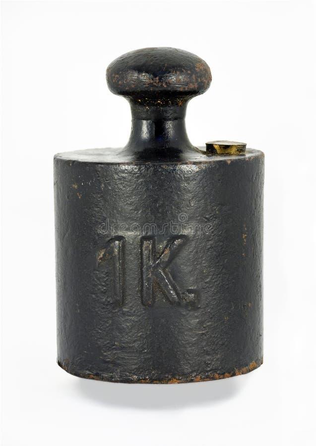 Vieux poids noir d'un kilogramme images libres de droits