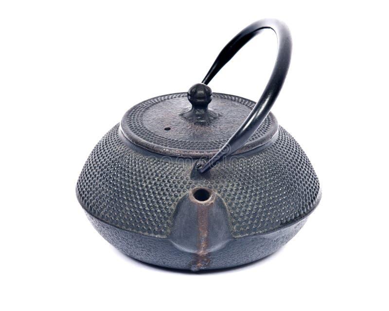 Vieux pot de thé de fonte photos stock