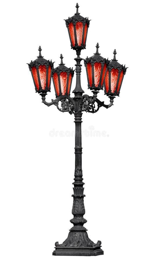 Vieux poteau de lampe de fer de moulage avec la glace rouge photographie stock libre de droits