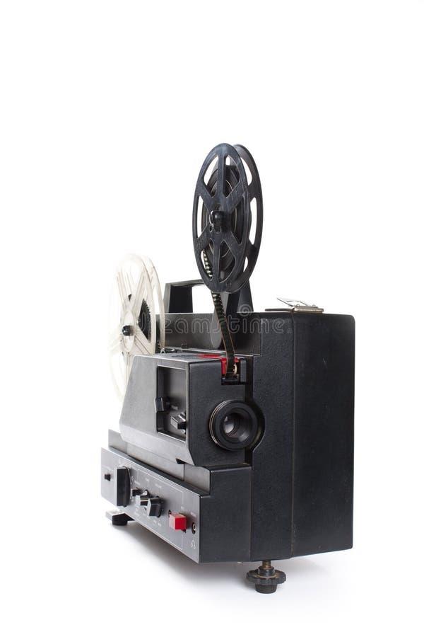 Vieux projecteur de film sur un fond blanc photographie stock libre de droits