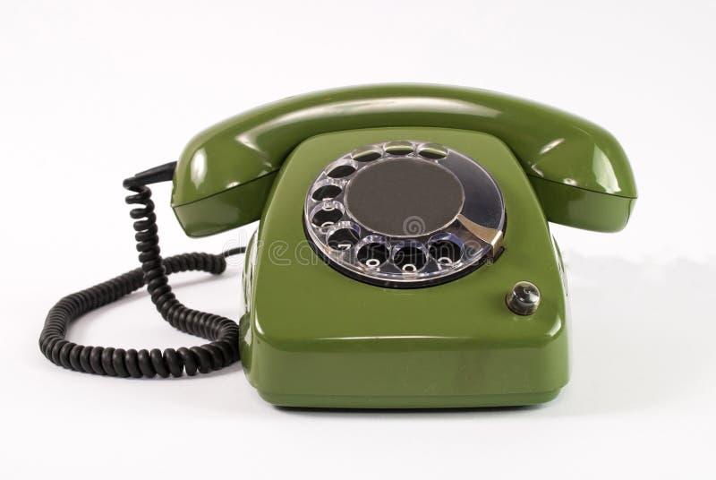 Vieux rétro téléphone vert sur le fond blanc photographie stock libre de droits