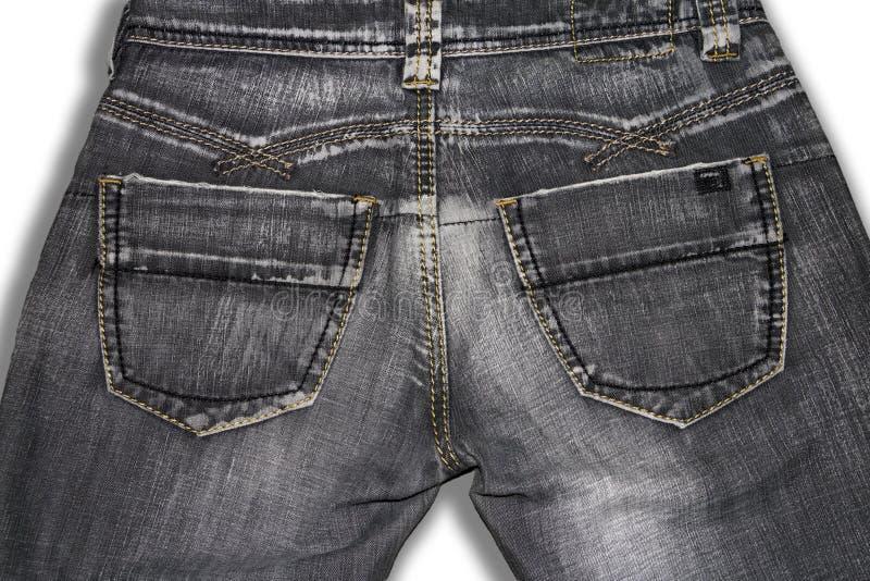 Vieux rétros jeans gris, vue arrière photo stock