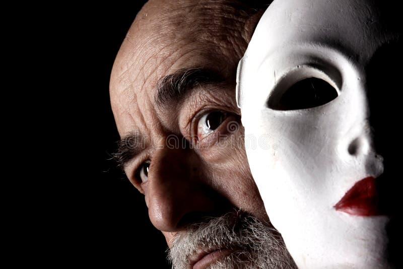 Vieux regard et masque photographie stock