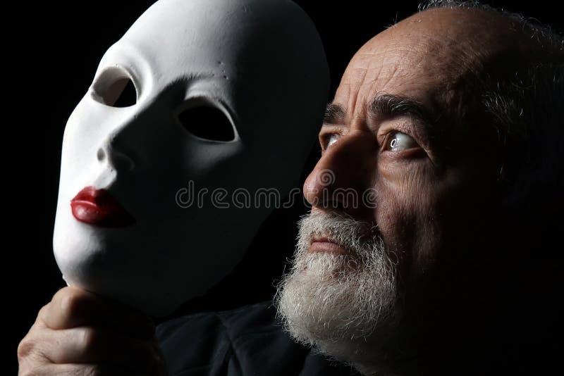 Vieux regard et masque images libres de droits