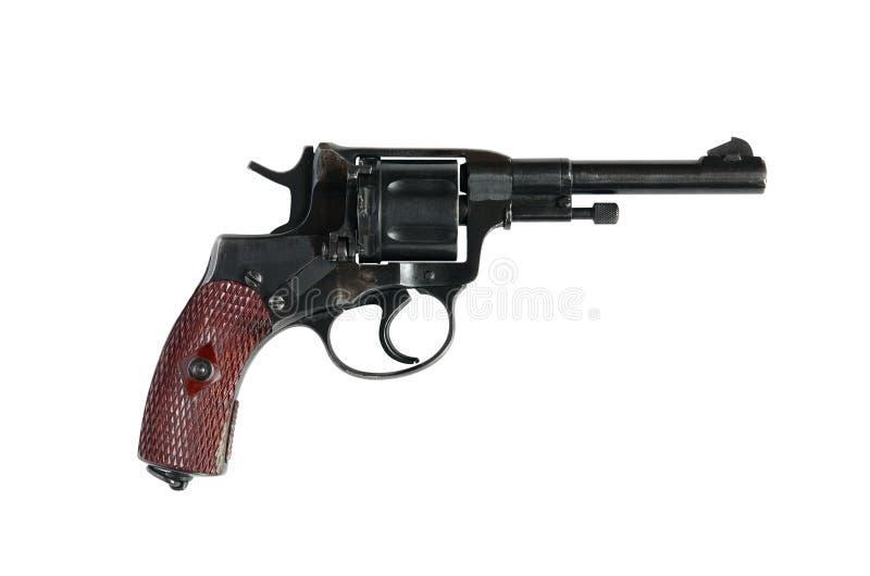 Vieux revolver sur le blanc images stock