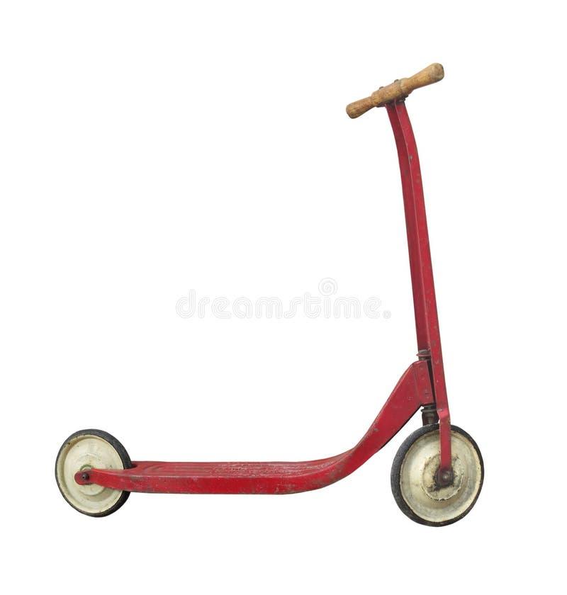 Vieux scooter de poussée d'enfant d'isolement photos stock