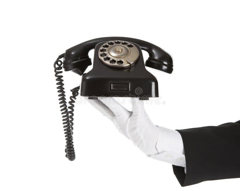 Vieux téléphone dans la main de battler images stock