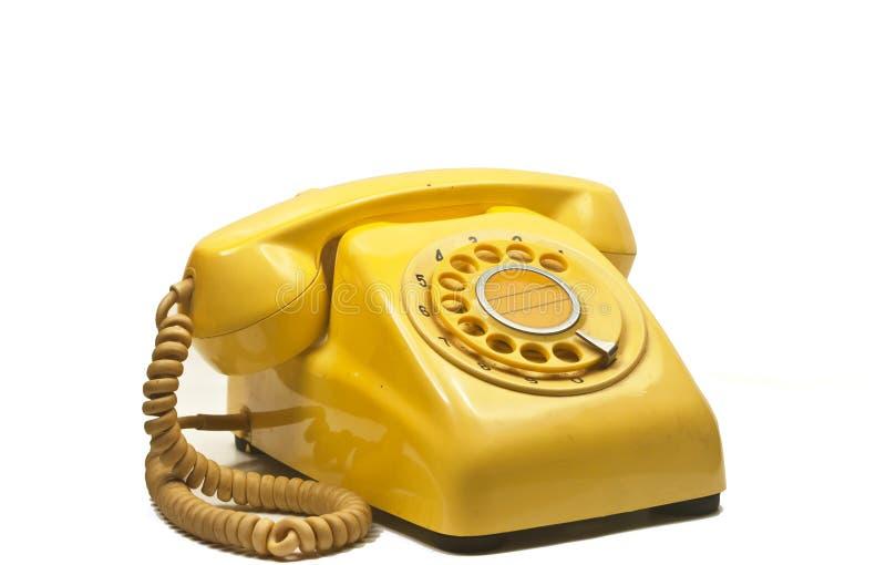 Vieux téléphone de cru sur le blanc photographie stock libre de droits