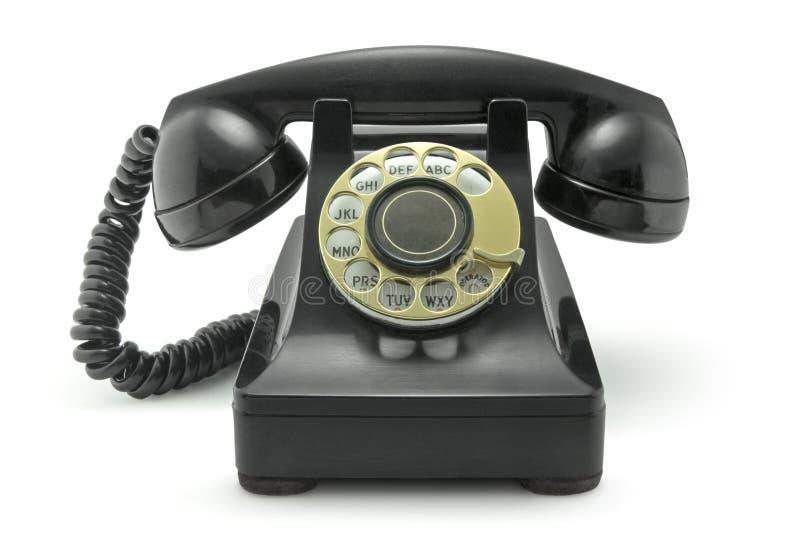 Vieux téléphone de cru sur le blanc photographie stock