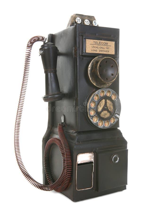 Vieux téléphone de salaire de cru image stock