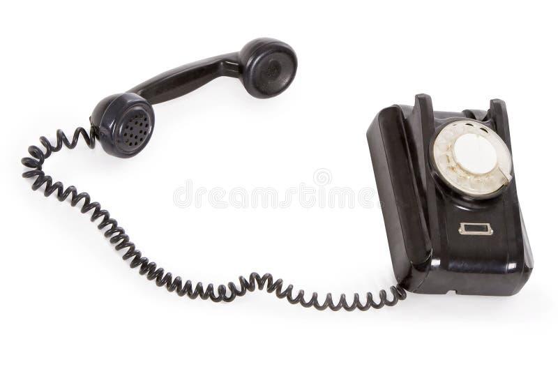 Vieux téléphone noir d'isolement au-dessus du blanc photo stock