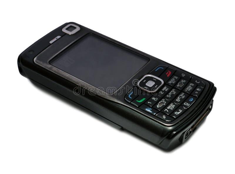 Vieux téléphone portable au-dessus de blanc photographie stock libre de droits