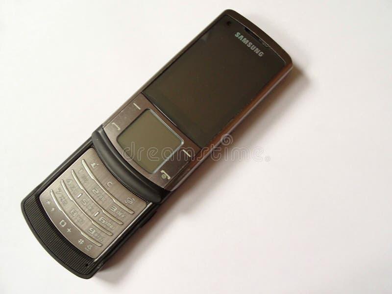 Vieux téléphone portable sur un fond blanc photo libre de droits