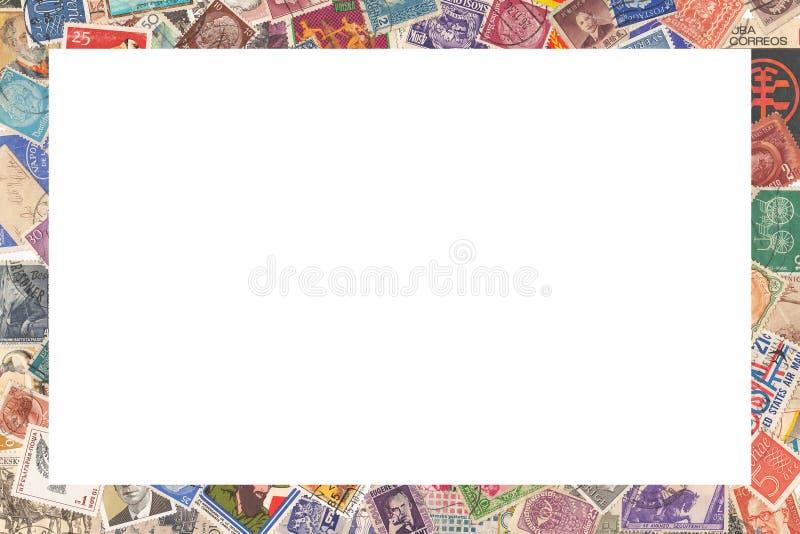 Vieux timbres-poste de différents pays, cadre photos libres de droits