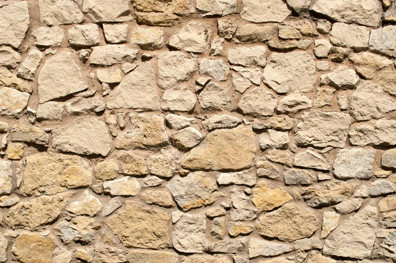 Vieux ton brun clair de mur en pierre photographie stock libre de droits